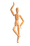 Wood mannequin holds balance on one leg Royalty Free Stock Photography