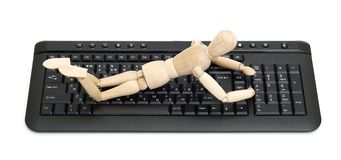 Wood mannequin on a keyboard Royalty Free Stock Image