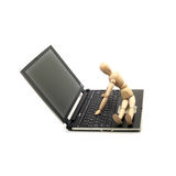 Wood mannequin and laptop royalty free stock photo