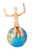 Wood mannequin sitting on top of a world globe to protect isolat Royalty Free Stock Photo