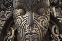 Wood maori mask from god holy. Maori culture mask made from wood. Carving is holy and can be found in new zealand royalty free stock photos