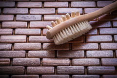Wood massager and scrubbing brush on textured wooden matting hea Royalty Free Stock Photos