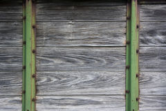 Wood and metal background from old farm machinery. Planks of weathered wood and green metal posts from old farm machinery Royalty Free Stock Image