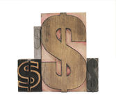Wood and metal dollar signs. Four dollar signs in old letterpress wood and metal typefaces isolated on white royalty free stock photos