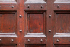 Wood and metal door with metallic spikes looking worn and grungy Royalty Free Stock Image