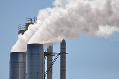 Wood Mill Smoke Stacks Stock Photo