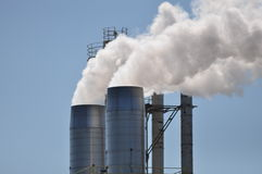 Wood Mill Smoke Stacks Stock Photography