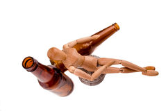 Wood model drunk with beer Royalty Free Stock Photos
