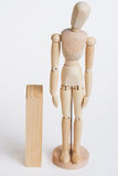 Wood model standing near wood Royalty Free Stock Photos