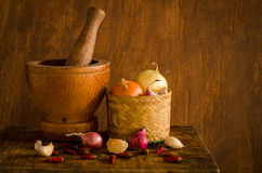 Wood mortar and many spices Stock Photo