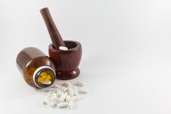 Wood mortar and medecine. Royalty Free Stock Images