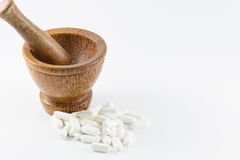 Wood mortar and medecine. Stock Image