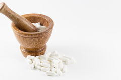 Wood mortar and medecine. Stock Photography