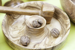 Wood mortar with nuts Royalty Free Stock Image