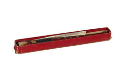 Wood musical instrument flute in red box on white background Royalty Free Stock Images