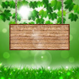 Wood Notice on Blurred Spring Background Stock Image