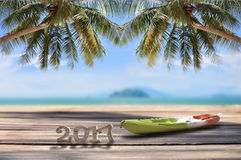 Wood number 2017 with kayak on plank on tropical beach background Royalty Free Stock Images