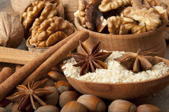 Wood nut, walnut, anise. Cinnamon and sesame against a dark background Royalty Free Stock Photography