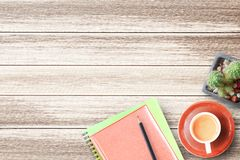 Wood office desk table with notebook,pencil and cup of coffee fl. Wood office desk table with notebook,pencil,cactus flower and cup of coffee flat lay. Top view Stock Image