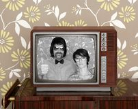 Wood old tv nerd silly couple retro man woman. Wood old tv nerd silly couple retro man vintage woman on wallpaper Royalty Free Stock Photography