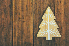 Wood ornament Christmas tree on weathered plank wood background, copy space for text, template for greeting card Stock Photos
