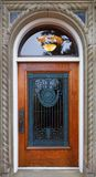Wood and ornate grill door Stock Photography