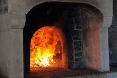 Wood oven. Preparing bread in wood oven Royalty Free Stock Image