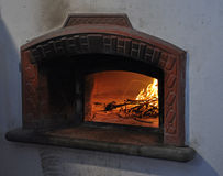 Traditional stone bread oven and open fire Stock Image