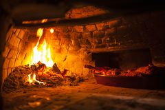Wood oven with orange flames stock images
