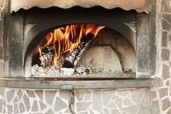 Wood oven, preparation of heating for pizza Stock Photos