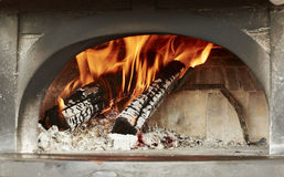 Wood oven, preparation of heating for pizza baking Stock Images