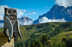 Wood owl. Wood sculpture with background mountains stock images