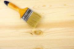 Wood and paintbrush Stock Photography