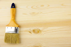 Wood and paintbrush / covering by varnish Stock Image