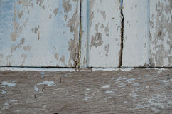 Wood painted a faded old paint peeling off a stunning clinched. Royalty Free Stock Photos