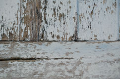 Wood painted a faded old paint peeling off a stunning clinched. Royalty Free Stock Images