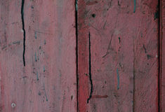 Wood painted a faded old paint peeling off a stunning clinched. Stock Photos