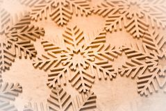 Wood painted snowflakes symbols. Photograph of some wood painted snowflakes symbols Stock Photo