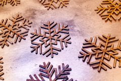 Wood painted snowflakes symbols. Photograph of some wood painted snowflakes symbols Stock Image