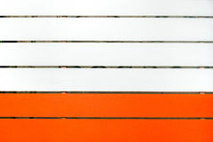 Wood painted in two colors, sofe orange and white.  Royalty Free Stock Photography