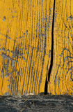 Wood painted yellow. Particularly an old wooden door yellow Royalty Free Stock Image