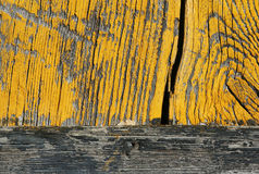 Wood painted yellow. Particularly an old wooden door yellow Royalty Free Stock Images