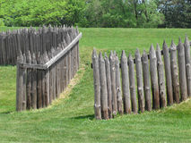 Wood palisade of old fort. Old wood palisade and entryway of an old fort Stock Image