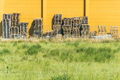 Wood pallets piles. Stacks of wooden pallets in a warehouse, original and panoramic point of view Stock Photos