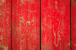 Wood panel with chipped red paint. Grunge Style. Red paint on antique wood panels Stock Photo
