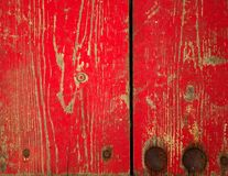 Wood panel with chipped red paint. Grunge Style. Red paint on antique wood panels Stock Photos