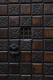 Wood panelled door with carved panels Stock Images