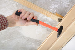 Wood panelling the ceiling. Contractor installing wood panels on a ceiling Stock Photography