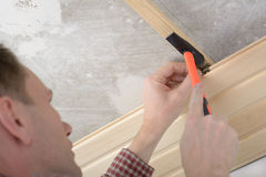 Wood panelling the ceiling. Contractor installing wood panels on a ceiling Royalty Free Stock Image