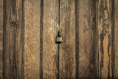 Wood panels background with lock in the middle Stock Photography